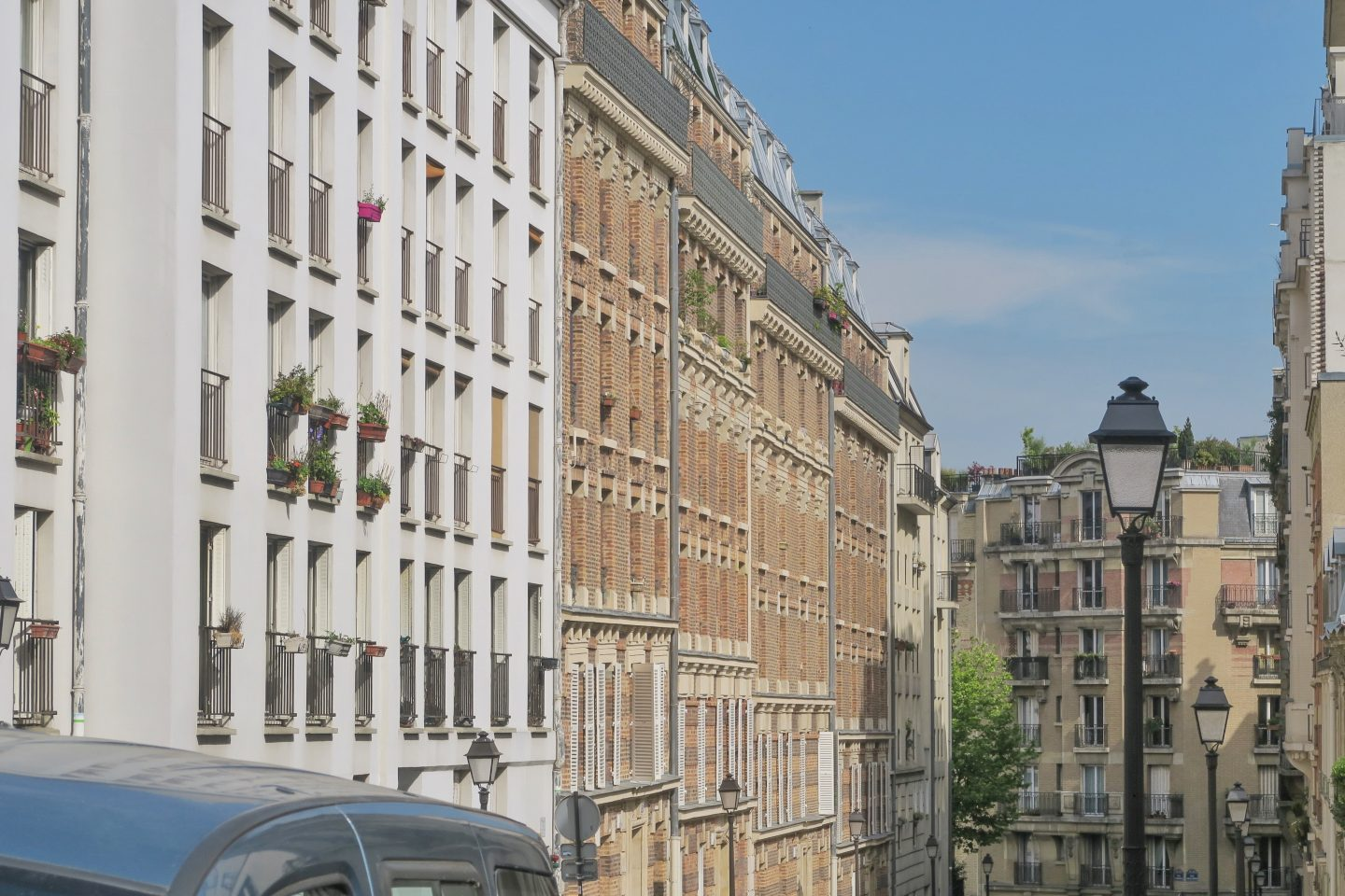 A row of Parisian houses on Monmarte in day trip to Paris on a budget on francescasophia.co.uk