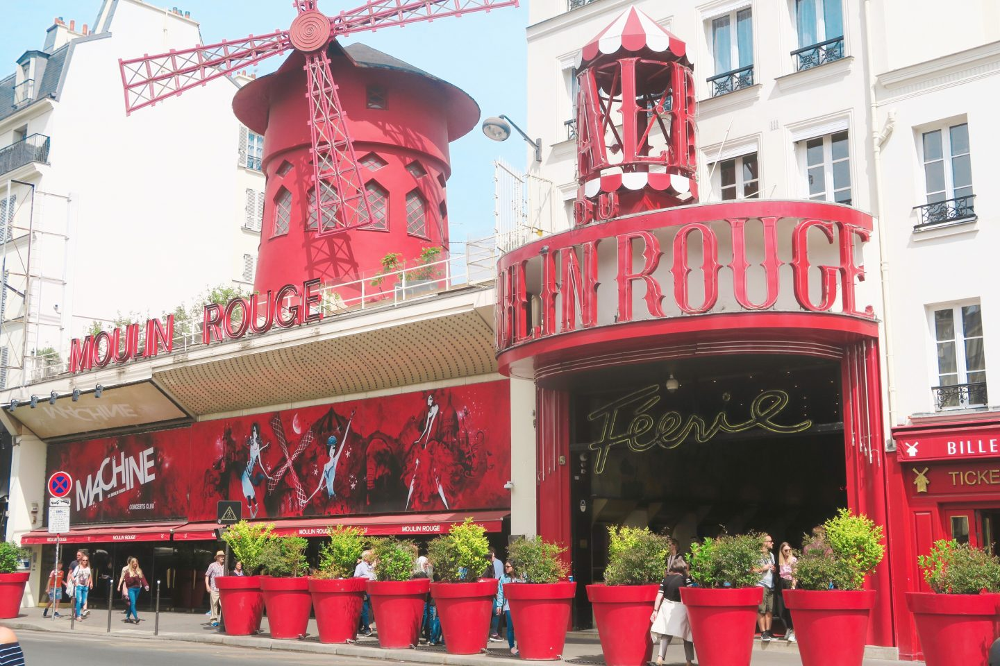 The outside of the Moulin Rouge A row of Parisian houses on Monmarte in day trip to Paris on a budget on francescasophia.co.uk