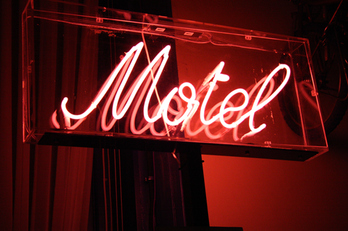 a neon pink light with 'motel' from motelrocks lit up