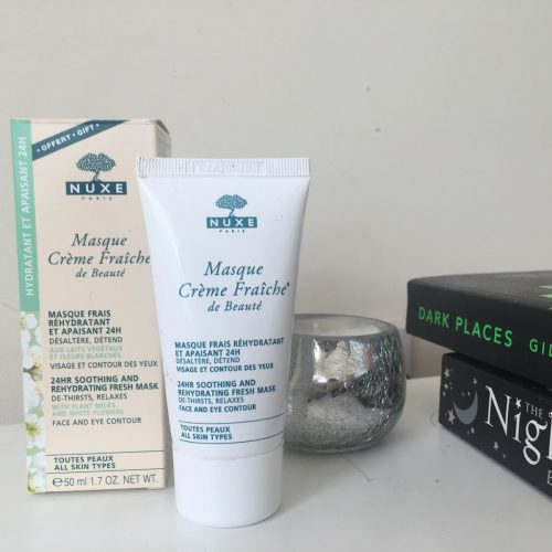 nuxe crème fraiche 24hr moisturising mask next to its original box, sitting on a white desk