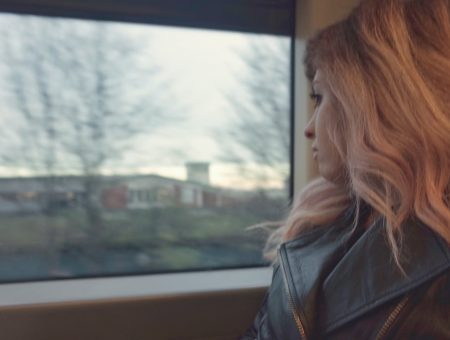 blogger francesca sophia turned away from the camera, looking out of a train window