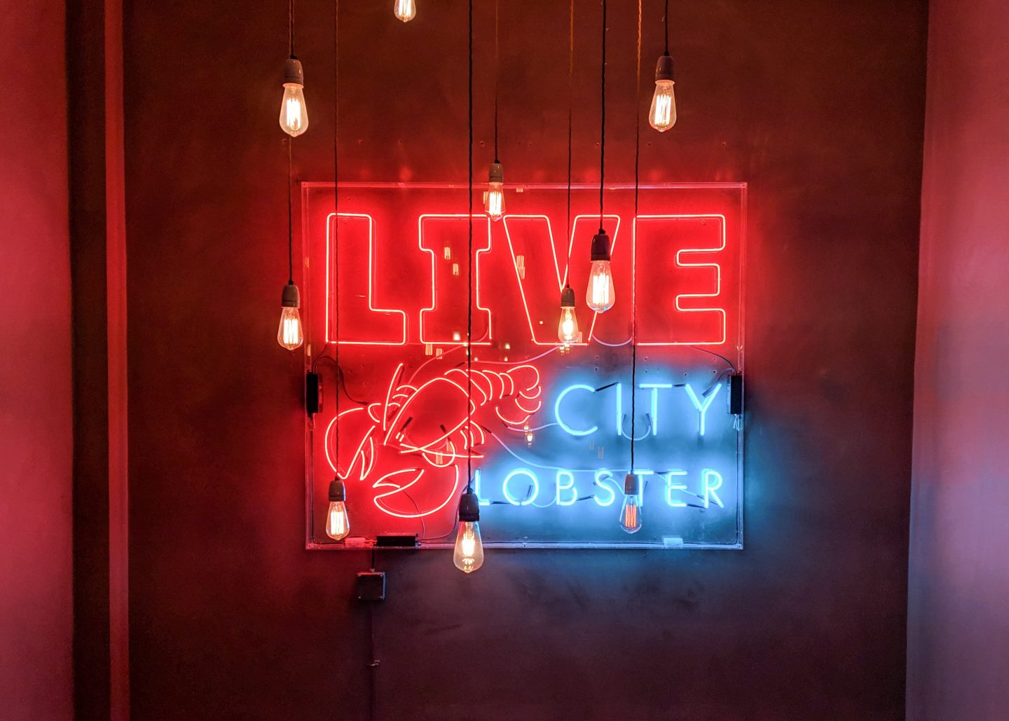 Neon sign that reads 'live city lobster' at the Burger & Lobster Soho branch on francescasophia.co.uk